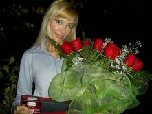 Bouquet of red roses and Box of chocolate to Ukraine