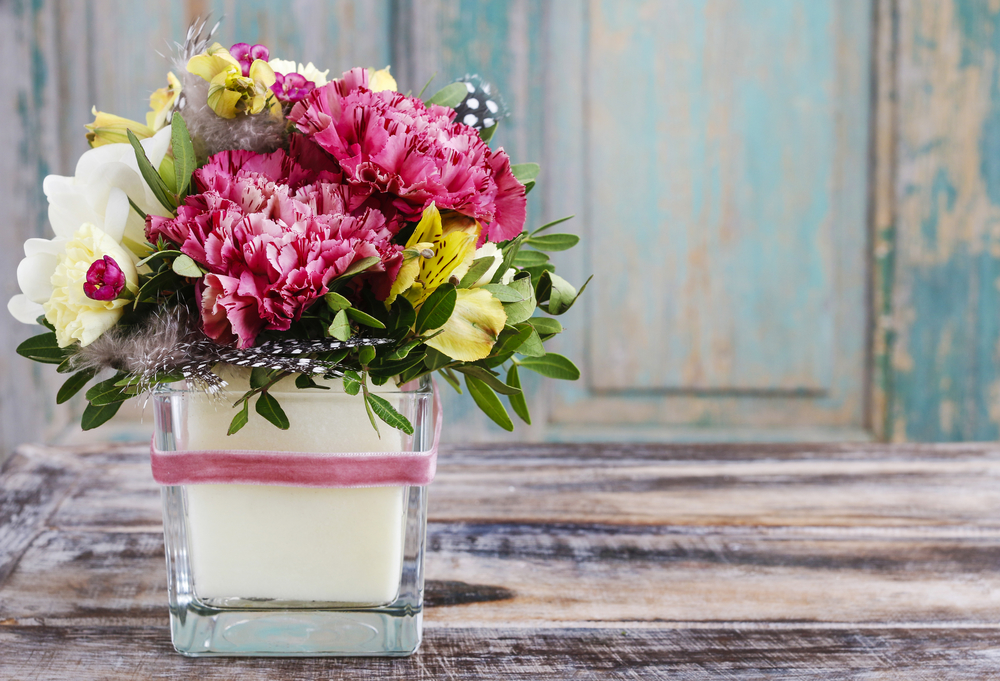 January Birth Flower - Carnations in a candle